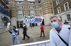 © Licensed to London News Pictures. 30/11/2015. London, UK.  National Health Service workers and other supporters protest against the National Health Service (NHS) being part of the Transatlantic Trade and Investment Partnership (TTIP) by carrying a giant version of their petition past the Department of Health. Photo credit: Peter Macdiarmid/LNP
