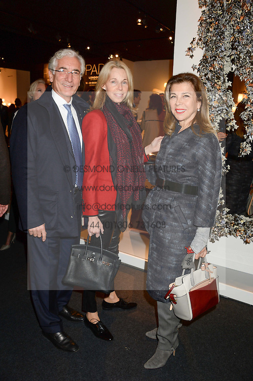 Left to right, SIR RONALD & LADY COHEN and PRINCESS FIRYAL OF JORDAN at the PAD Art and Design Fair 2013 Collectors Preview in Berkeley Square, London on 14th October 2013.