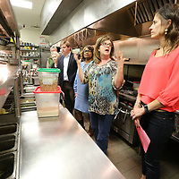 Park Heights owner Blair Hughes, center right, shows the celebrity chefs like Lori Bevering, right, and others their stations during a tour of the kitchen as they get ready for this year's annual Cooking Like the Stars fund raiser for the North Mississippi Boys & Girls Club.