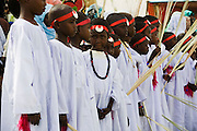 Young boys between the ages of 8 and 13 gather in the streets outside the compound of the Govenor of the war-torn region of north Darfur, Sudan. Dressed in white gowns and wearing red bandanas, they will soon celebrate a Sudanese rite of passage, the male circumcision. When they have recited the entire Qur'an [Koran] once through will they generally endure this traditional practice