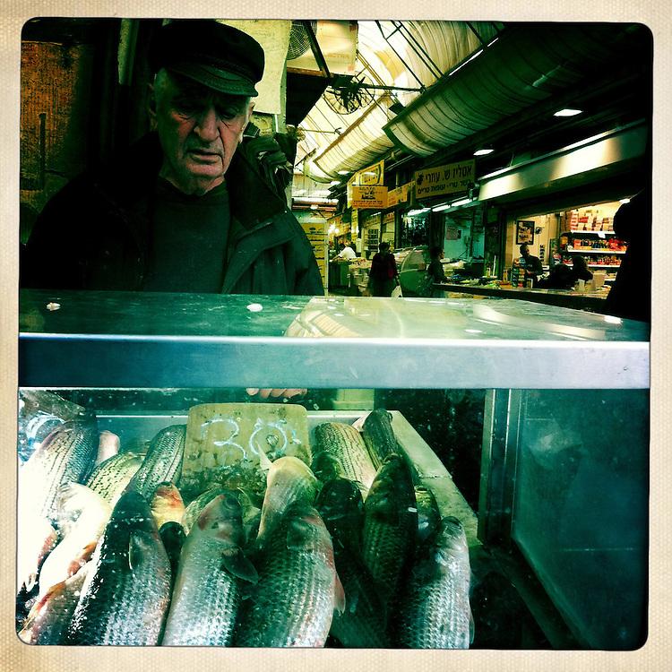 A fishmonger at the Mechaneh Yehuda market in Jerusalem, Israel
