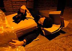 UK ENGLAND LONDON DEC06 - Posed photograph of a homeless photographer sleeping rough in a cardboard box on a London pavement. This is what happens when you give up your copyright.....jre/Photo by Jiri Rezac....© Jiri Rezac 2006....Contact: +44 (0) 7050 110 417..Mobile:  +44 (0) 7801 337 683..Office:  +44 (0) 20 8968 9635....Email:   jiri@jirirezac.com..Web:    www.jirirezac.com....© All images Jiri Rezac 2006 - All rights reserved.