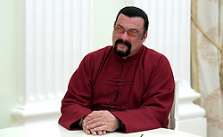 November 25, 2016 - Moscow, Russia - American actor Steven Seagal listens to Russian President Vladimir Putin during a visit in the Kremlin November 25, 2016 in Moscow, Russia. During the meeting Putin presented a Russian passport to Seagal making him a Russian citizen. (Credit Image: © Alexei Druzhinin/Planet Pix via ZUMA Wire)