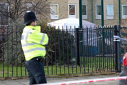 © Licensed to London News Pictures. 04/02/2018. London, UK. Police and a forensic tent at the crime scene in Abbey Road, Barking. A 19 year old man suffering stab wounds was attended to by emergency services last night and was prouncounced dead at the scene at 22:55. Photo credit: Vickie Flores/LNP