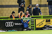 Ball girl holding aloft a scarf during the match during the EFL Sky Bet League 2 match between Forest Green Rovers and Grimsby Town FC at the New Lawn, Forest Green, United Kingdom on 22 January 2019.