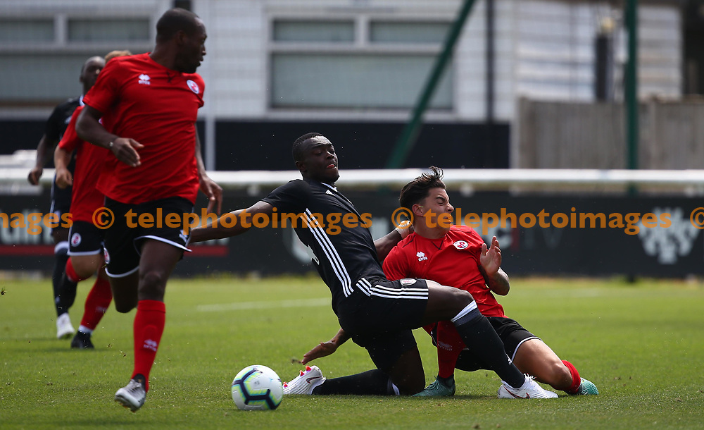 Reece Grego-Cox is tackled  during the pre season friendly between Fulham and Crawley Town at Motspur Park Training Ground, London, UK. 07 July 2018.