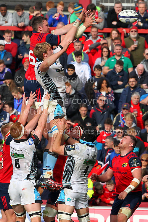 Peter O'Mahony of Munster and Jonny Gray of Glasgow Warriors jump for a line out ball.. European Rugby Champions cup match, pool one, Munster Rugby v Glasgow Warriors at Thomond Park in Limerick , Ireland on Saturday 22nd October 2016.<br /> pic by  John Halas, Andrew Orchard sports photography.