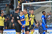 McMahon gets a yellow card for dissent during the EFL Sky Bet League 1 match between Rochdale and Scunthorpe United at Spotland, Rochdale, England on 23 March 2019.