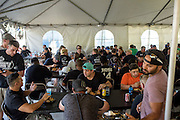 Philadelphia, Pennsylvania - September 17, 2015: Workers eat lunch inside the crew tent Thursday September 17th, 2015. <br /> <br /> <br /> Scott Mirkin's company ESM is heading the production of The World Meeting Of Families and Pope Francis's visit to Philadelphia this Fall. The events will take place along the Benjamin Franklin Parkway.<br /> <br /> CREDIT: Matt Roth for The New York Times<br /> Assignment ID: 30179397A
