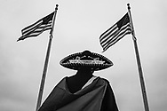 A protestor, student from Mexico walks in between american flags as protest during the Women's March on Washington, one day after Trump's inauguration, Saturday, Jan. 21, 2017 in Washington.