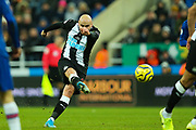 Jonjo Shelvey (#8) of Newcastle United hits a shot from outside the penalty box during the Premier League match between Newcastle United and Chelsea at St. James's Park, Newcastle, England on 18 January 2020.