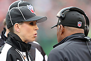Line judge Sarah Thomas (53) talks to Cincinnati Bengals head coach Marvin Lewis near the sideline during the Cincinnati Bengals 2016 NFL week 13 regular season football game against the Philadelphia Eagles on Sunday, Dec. 4, 2016 in Cincinnati. The Bengals won the game 32-14. (©Paul Anthony Spinelli)