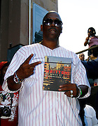 """Grandmaster Caz holds his book """"Written"""" during the City Parks Foundation Salute to Hip Hop event at Von King Park in Brooklyn, New York on June 18, 2014."""