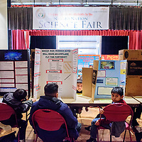 Elementary students await the judges for their projects on day one of the 2018 Navajo Nation Science Fair at Red Rock Park Feb 27.