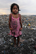 These children live in the former dumpsite Smokey Mountain in Vitas, Tondo. The dumpsite still remains although on a less massive scale. These are children in Vitas, Tondo, Manila, Philippines. They go to school in a nearby public school but need to pass though mud and garbage to get there. Copyright 2008 Children of Vitas, Tondo, Philippines. They are children who were born and raised amidst the garbage surrounding the charcoal-makers of Vitas, Tondo.