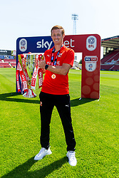 (Free to use courtesy of Sky Bet) Eoin Doyle lifts the trophy as Swindon Town gather at The County Ground to celebrate becoming Sky Bet League Two Champions, with a socially distanced trophy lift, after the curtailment of the regular season due to the Covid-19 pandemic - Rogan/JMP - 26/06/2020 - The County Ground - Swindon, England - Sky Bet League 2.