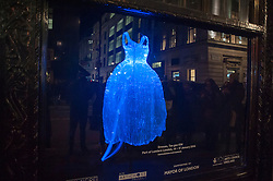 "© Licensed to London News Pictures. 14/01/2016. London, UK. ""Dresses"" by Tae gon Kim in the Liberty store.  The work forms part of Lumiere London, a major new light festival which commenced today to be held over four evenings and featuring artists who work with light.  The event is produced by Artichoke and supported by the Mayor of London.  Photo credit : Stephen Chung/LNP"