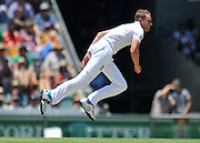 Broad follows through while bowling from the Vulture Street end early on Day 1 of the 1st Test in the 2013-14 Ashes Cricket Series between Australia and England at the GABBA (Brisbane, Australia) from Thursday 21st November 2013<br /> <br /> Conditions of Use : NO AGENTS ~ This image is subject to copyright and use conditions stipulated by Cricket Australia.  This image is intended for Editorial use only (news or commentary, print or electronic) - Required Image Credit : &quot;Steven Hight - AURA Images&quot;