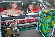 Arbat pedestrian zone. Street painter in front of an advertising poster...A river cruise from Moscow to St. Petersburg aboard MS Kazan, the most luxurious vessel (four star plus) operating in Russia. It is run by Austrian River Cruises under strictly Western standards, chartered - amongst others - by Club 50, a senior's travel agency based in Vienna.