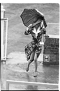 Lady running in the rain Ascot. 17.06.87© Copyright Photograph by Dafydd Jones 66 Stockwell Park Rd. London SW9 0DA Tel 020 7733 0108 www.dafjones.com