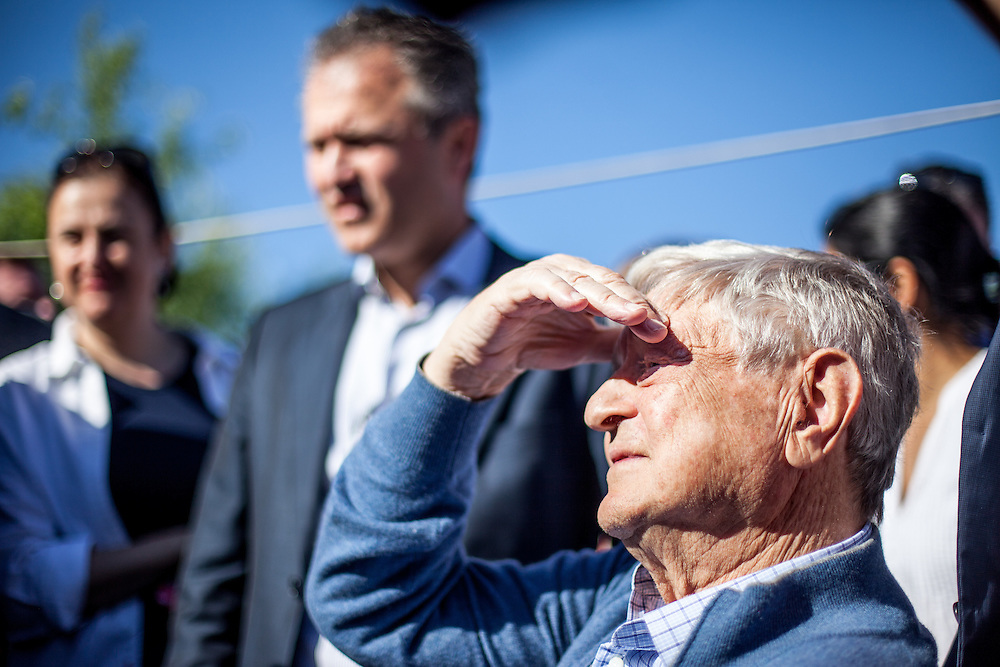 George Soros, chairman and founder of the Open Society Foundations, visiting the Roma part of Frumusani.