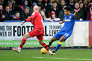 AFC Wimbledon striker Lyle Taylor (33) crossing the ball during the EFL Sky Bet League 1 match between AFC Wimbledon and Walsall at the Cherry Red Records Stadium, Kingston, England on 25 February 2017. Photo by Matthew Redman.