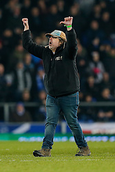 A crew member urges the crowd to boo as makers of the next installment in the 'Rocky' movie franchise use large equipment on the pitch during added time half time to record the Everton crowd for inclusion in the film itself - Photo mandatory by-line: Rogan Thomson/JMP - 07966 386802 - 19/01/2015 - SPORT - FOOTBALL - Liverpool, England - Goodison Park - Everton v West Bromwich Albion - Barclays Premier League.