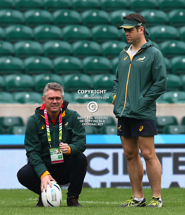 LONDON, ENGLAND - OCTOBER 16: Heyneke Meyer (Head Coach) of South Africa with Johann van Graan (Forwards Coach) of South Africa during the South African national rugby team Captains Run and media conference at Twickenham Stadium on October 16, 2015 in London, England. (Photo by Steve Haag/Gallo Images)