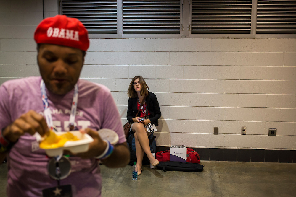 People sit outside the arena floor at the Democratic National Convention on Tuesday, September 4, 2012 in Charlotte, NC.