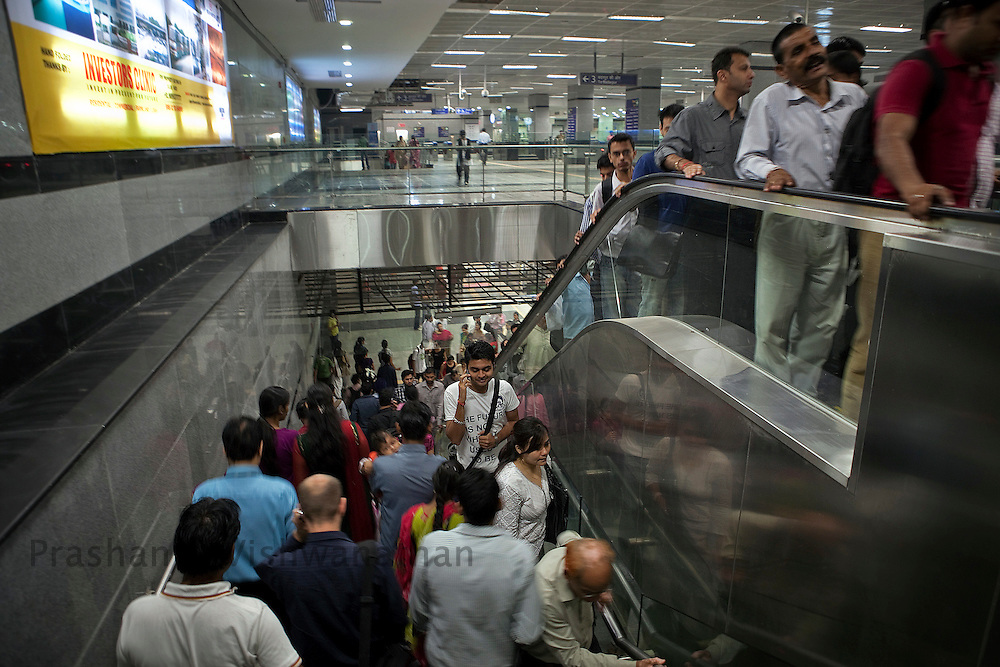 Passengers use the escalators at the Central Secratariat station of the Delhi Metro network in New Delhi, India, on Friday, October 22, 2010. Photographer: Prashanth Vishwanathan/HELSINGIN SANOMAT
