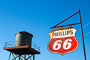 Old rusty Phillips 66 hanging sign and water tower in Louisiana, USA