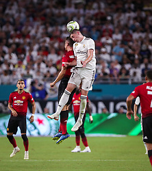July 31, 2018 - Miami Gardens, Florida, USA - Real Madrid C.F. midfielder Federico Valverde (37) leaps to head the ball above Manchester United F.C. midfielder Ander Herrera (21) during an International Champions Cup match between Real Madrid C.F. and Manchester United F.C. at the Hard Rock Stadium in Miami Gardens, Florida. Manchester United F.C. won the game 2-1. (Credit Image: © Mario Houben via ZUMA Wire)