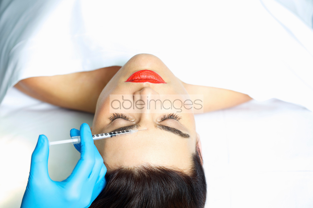 Woman Receiving Botox Injection on Forehead
