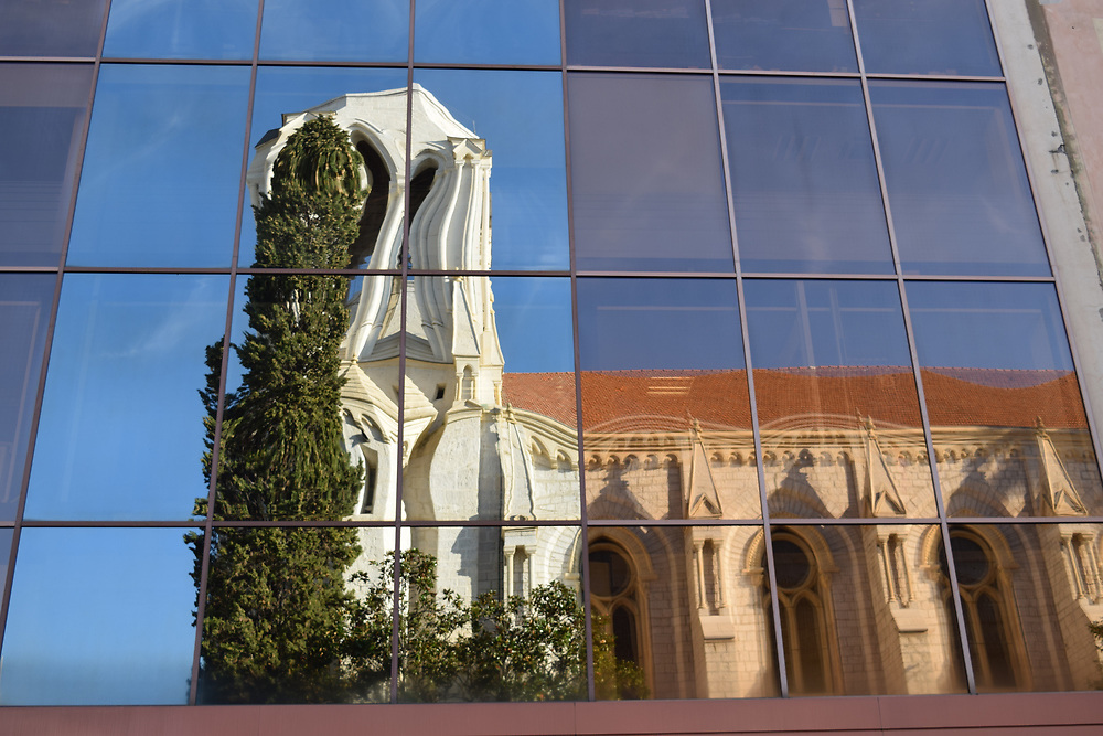 Reflections of a French Chruch in distorted glass