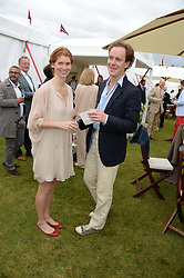 TOM INSKIP and LARA HUGHES YOUNG at the 2013 Cartier Queens Cup Polo at Guards Polo Club, Berkshire on 16th June 2013.