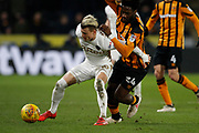 Ezgjan Alioski of Leeds United shields the ball from Ola Aina of Hull City during the EFL Sky Bet Championship match between Hull City and Leeds United at the KCOM Stadium, Kingston upon Hull, England on 30 January 2018. Photo by Paul Thompson.