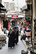 Muslim women wearing traditional robes veils shopping in The Grand Bazaar, Kapalicarsi, great market, Beyazi, Istanbul, Turkey