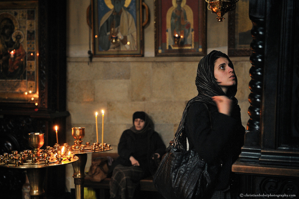 A gitl prays at a Church in Tbilisi.