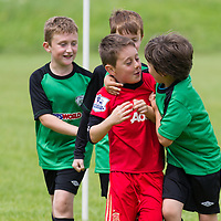 Young players celebrate during the Avenue Utd Summer Soccer Camp