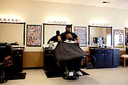 Larry Live gets his hair cut by Master Barber Mario Jones at Brown's Barbershop in Memphis, Tennessee October 15, 2011.