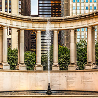 Chicago Millennium Monument Wrigley Square panorama photo. Millennium Monument is a peristyle monument in Millennium Park with a fountain and greek style columns. On the front it displays the names of the founders of Millenium Park. Panorama photo ratio is 1:3.