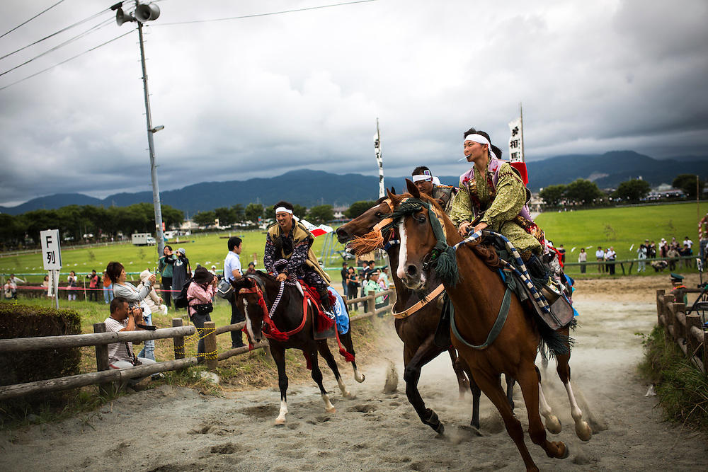 """MINAMISOMA, JAPAN - JULY 23 : A samurai horseman take part in the Yoinori Horse Race (pre-event) to purify the riding ground during the first day of Soma Nomaoi festival at Hibarigahara field on Saturday, July 23, 2016 in Minamisoma, Japan. """"Soma-Nomaoi"""" is a 3 day traditional festival that recreates a samurai battle scene from more than 1,000 years ago. (Photo: Richard Atrero de Guzman/NURPhoto)"""