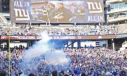 Feb 7, 2012; East Rutherford, NJ, USA; The New York Giants walk onto the field during the New York Giants Super Bowl XLVI Rally at MetLife Stadium.