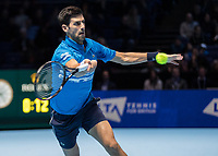 Tennis - 2019 Nitto ATP Finals at The O2 - Day One<br /> <br /> Singles Group Bjorn Borg: Novak Djokovic vs. Matteo Berrettini<br /> <br /> Novak Djokovic (Serbia) reaches across to make the passing shot<br /> <br /> COLORSPORT/DANIEL BEARHAM