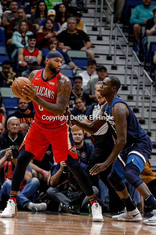 Nov 29, 2017; New Orleans, LA, USA; New Orleans Pelicans center DeMarcus Cousins (0) is defended by Minnesota Timberwolves center Gorgui Dieng (5) during the first quarter of a game at the Smoothie King Center. Mandatory Credit: Derick E. Hingle-USA TODAY Sports