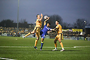 Sutton United Dean Beckwith (4) and Sutton United Captain Jamie Collins (6) battle for possession with AFC Wimbledon striker Lyle Taylor (33)  during The FA Cup match between Sutton United and AFC Wimbledon at Gander Green Lane, Sutton, United Kingdom on 7 January 2017. Photo by Stuart Butcher.