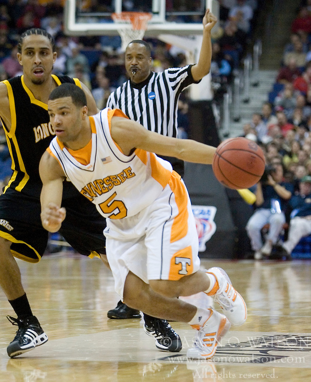 Tennessee Volunteers guard Chris Lofton (5) dribbles around Long Beach State 49ers guard Kejuan Johnson (1).  The #5 seed Tennessee Volunteers defeated the #12 seed Long Beach State 49ers 121-86  in the first round of the Men's NCAA Tournament in Columbus, OH on March 16, 2007.