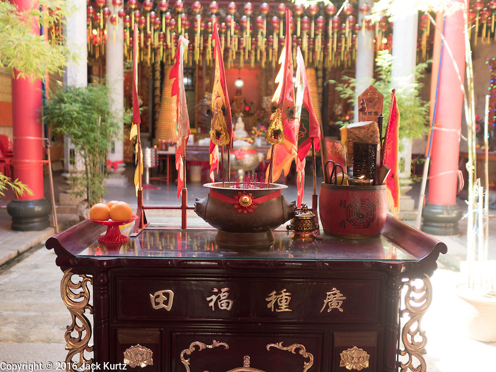 15 NOVEMBER 2016 - GEORGE TOWN, PENANG, MALAYSIA: An alter in the Temple of the Goddess of Mercy in George Town, Penang. George Town is a UNESCO World Heritage city and wrestles with maintaining its traditional lifestyle and mass tourism.           PHOTO BY JACK KURTZ