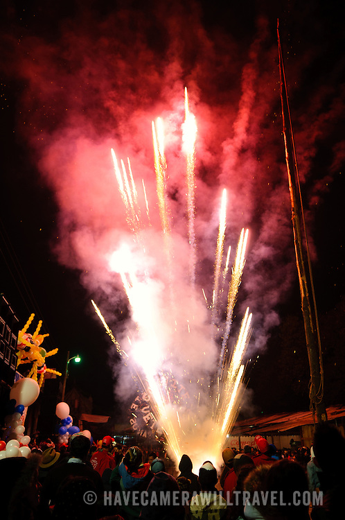 A crowd watches fireworks in the main street in front of the Church of Santo Tomas as part of Convite 12 de Dicembre in Chichicastenango in celebration of the Day of Our Lady of Guadalupe.. Chichicastenango is an indigenous Maya town in the Guatemalan highlands about 90 miles northwest of Guatemala City and at an elevation of nearly 6,500 feet. It is most famous for its markets on Sundays and Thursdays.