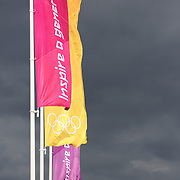 British Police stand under Olympic flags at the Athletes village, Olympic Park, Stratford during the London 2012 Olympic games. London, UK. 19th July 2012. Photo Tim Clayton